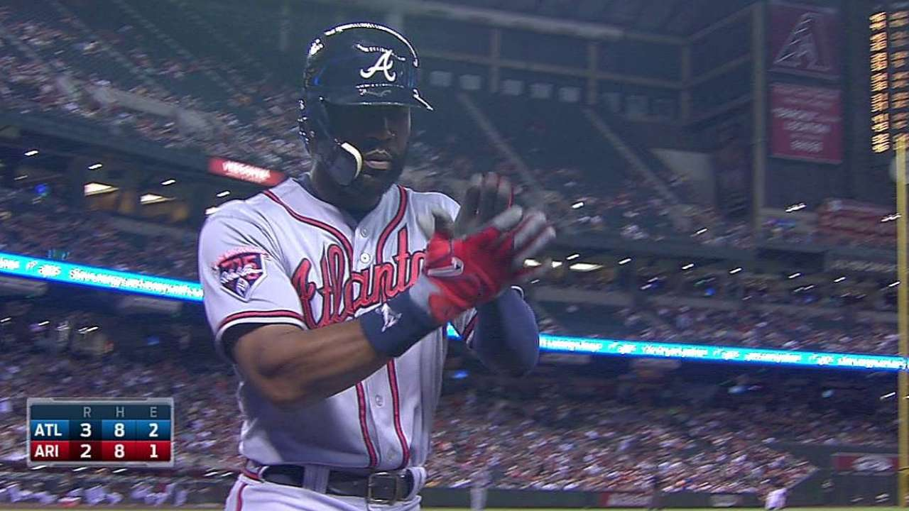 Braves cough up two late leads, fall in extras