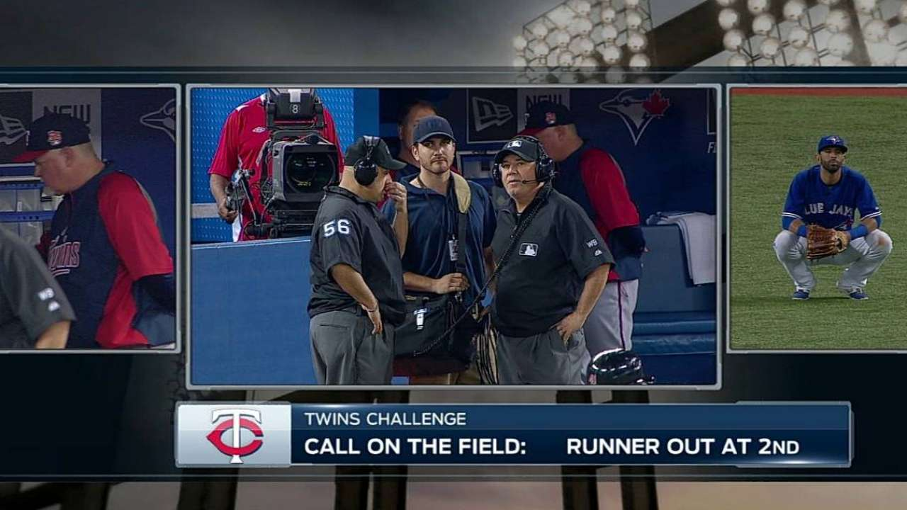 Twins lose challenge on Bautista's strong throw