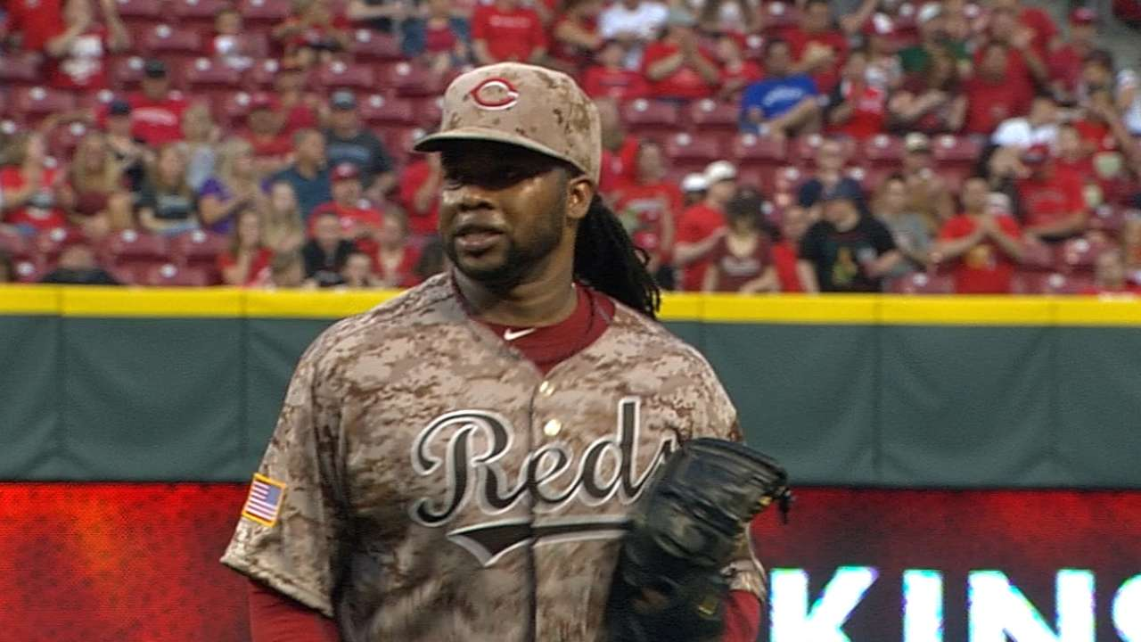 Cueto matches career high with 12 K's in win
