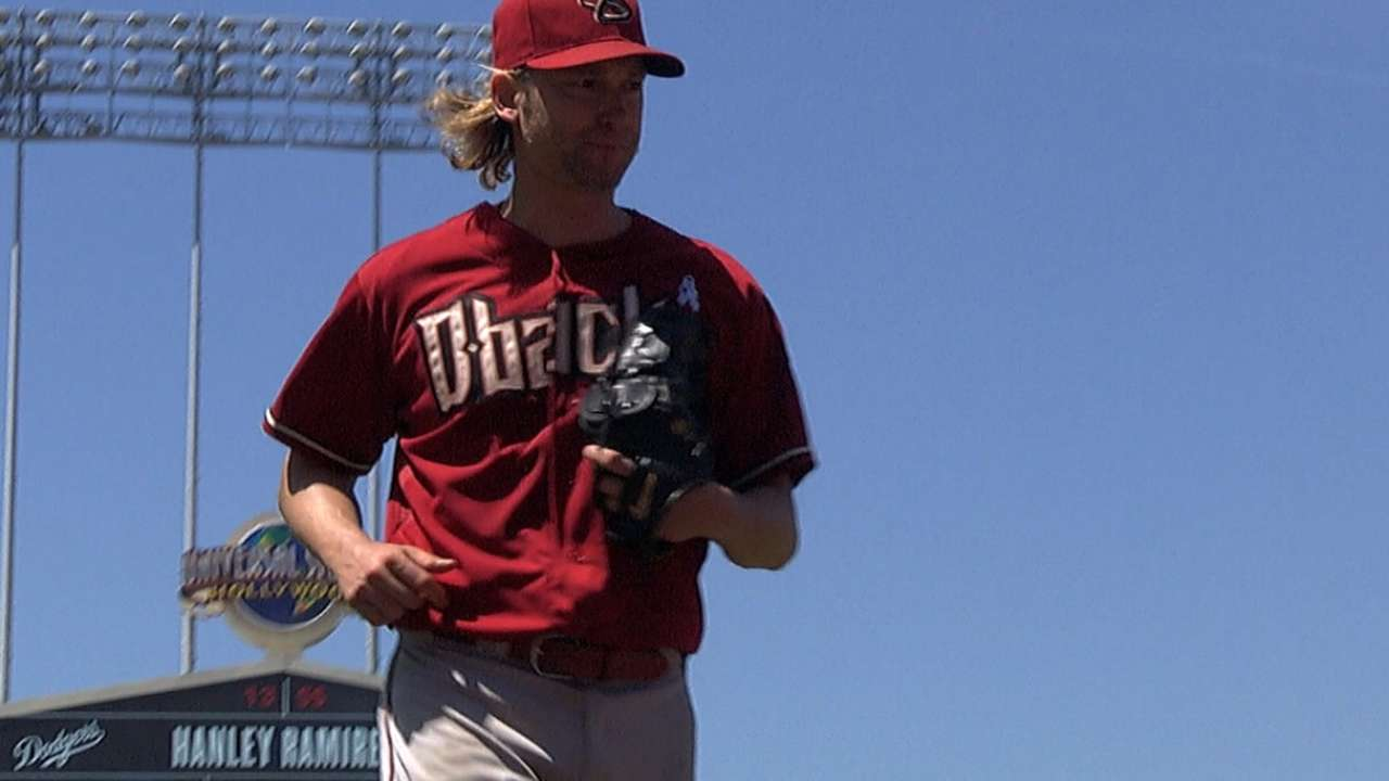 Arroyo plays catch while Trumbo nears Triple-A stint