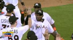 Ozuna's arm denies Mets, saves it for Alvarez