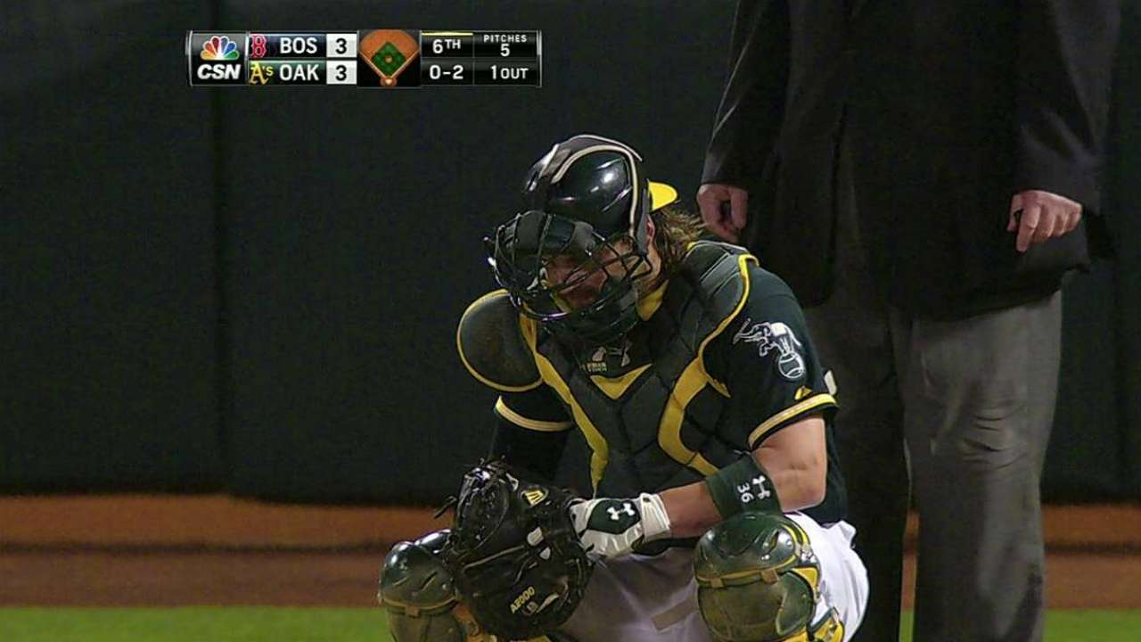 Norris out of A's lineup with bruised forearm
