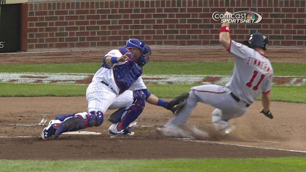 Review supports Cubs catcher on play at plate