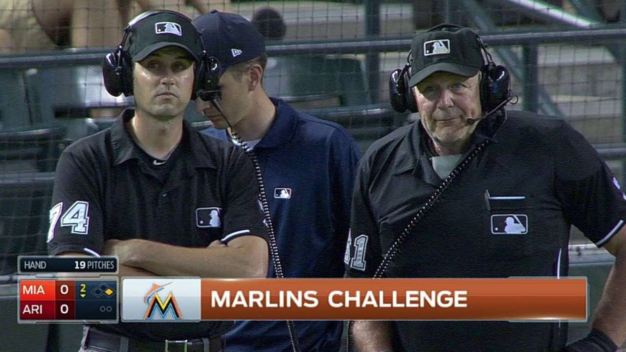 Marlins lose challenge on play at first