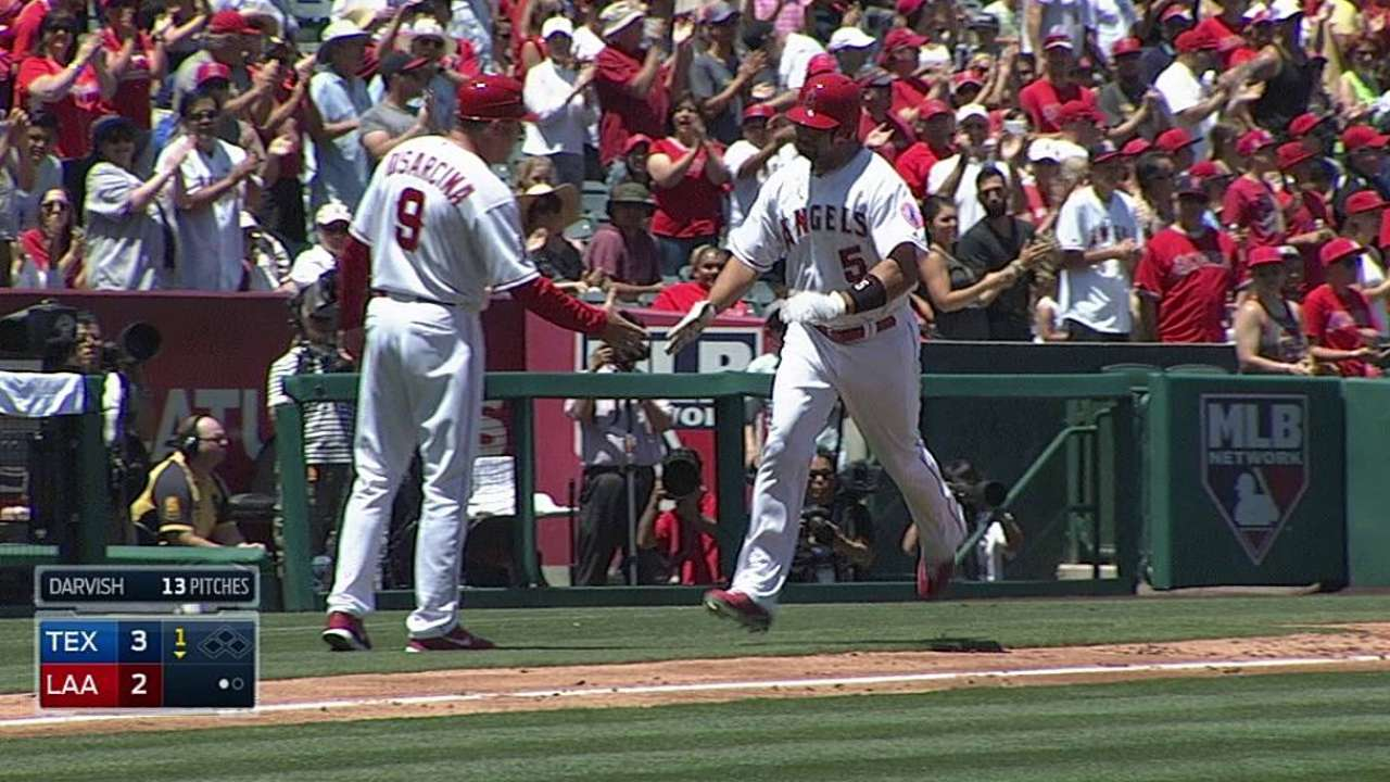 Pujols happy to DH in order to keep healthy