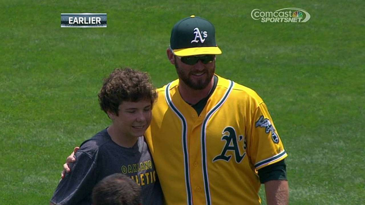 No robot needed: LeGrande throws first pitch