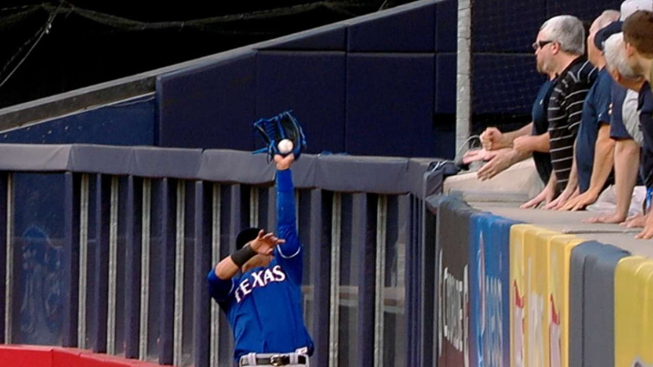 Martin robs McCann at wall with circus catch