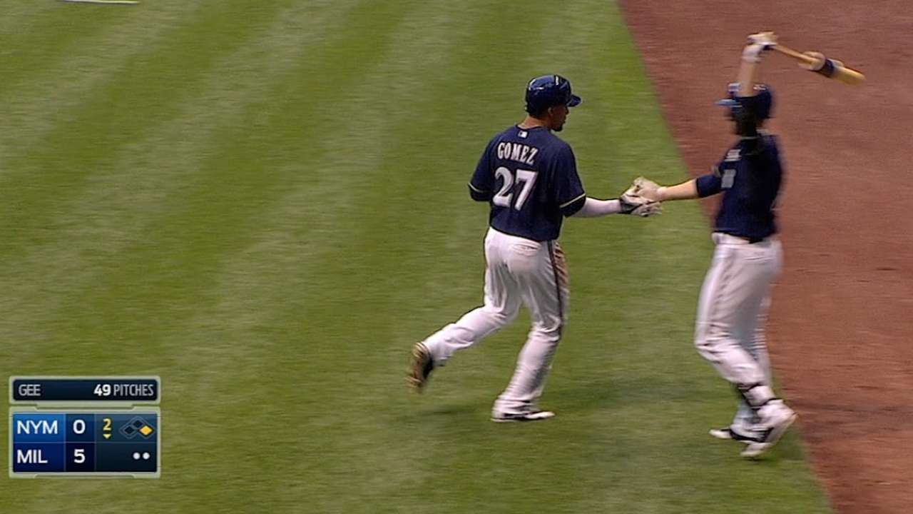 Brewers pile on runs to back Garza's solid effort
