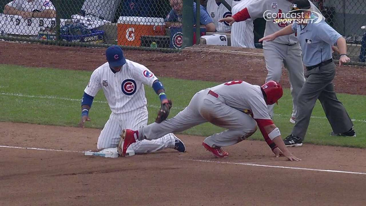 Cards' safe call stands, leads to run vs. Cubs