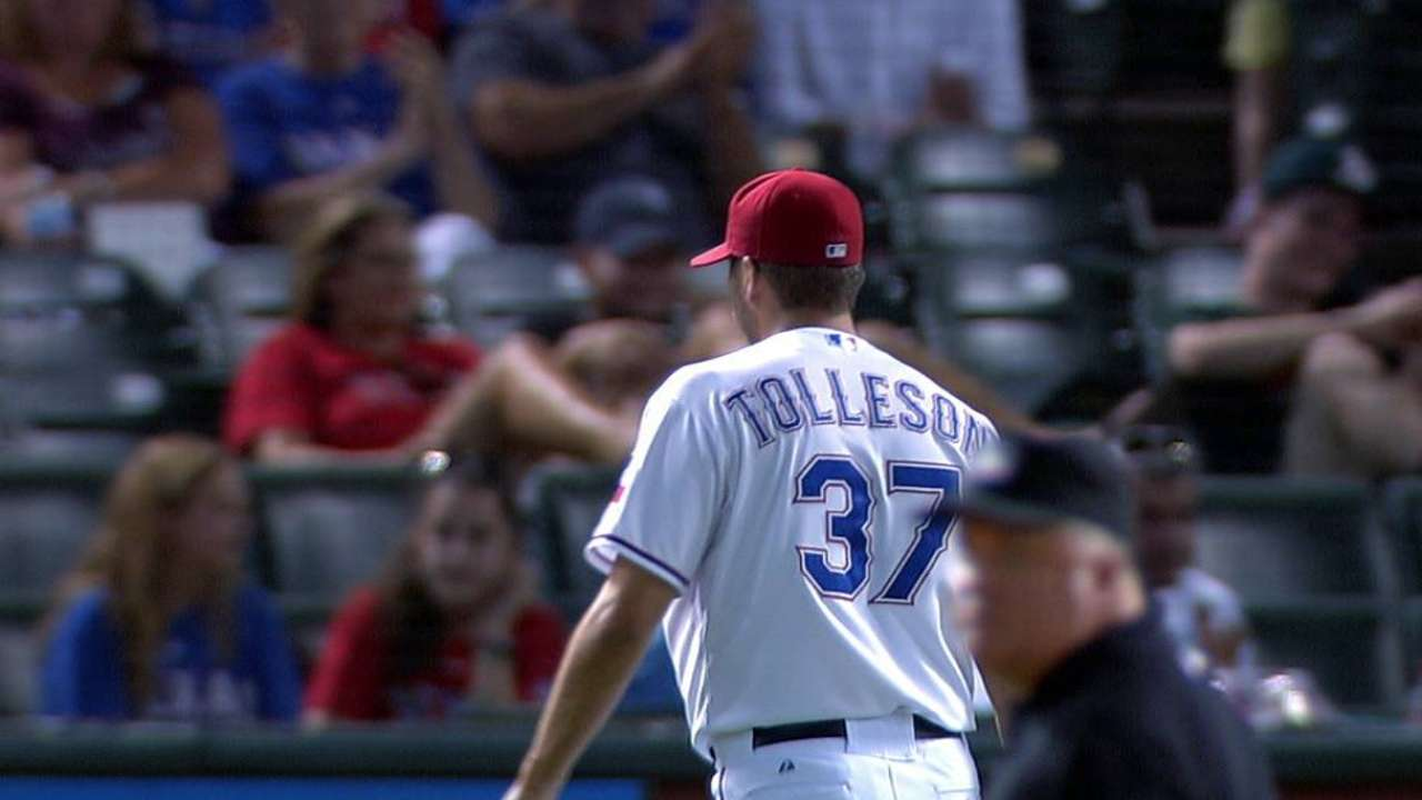 Tolleson saves a run