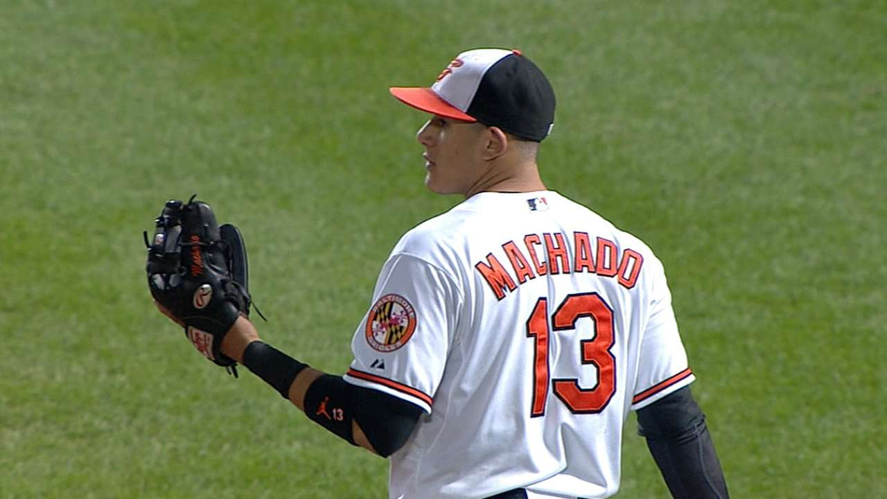Machado throws Pujols for a loop again