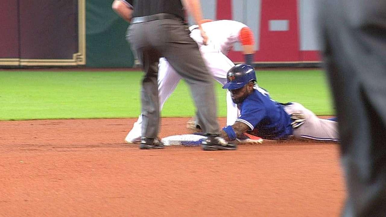 Reyes dings injured right shoulder on slide
