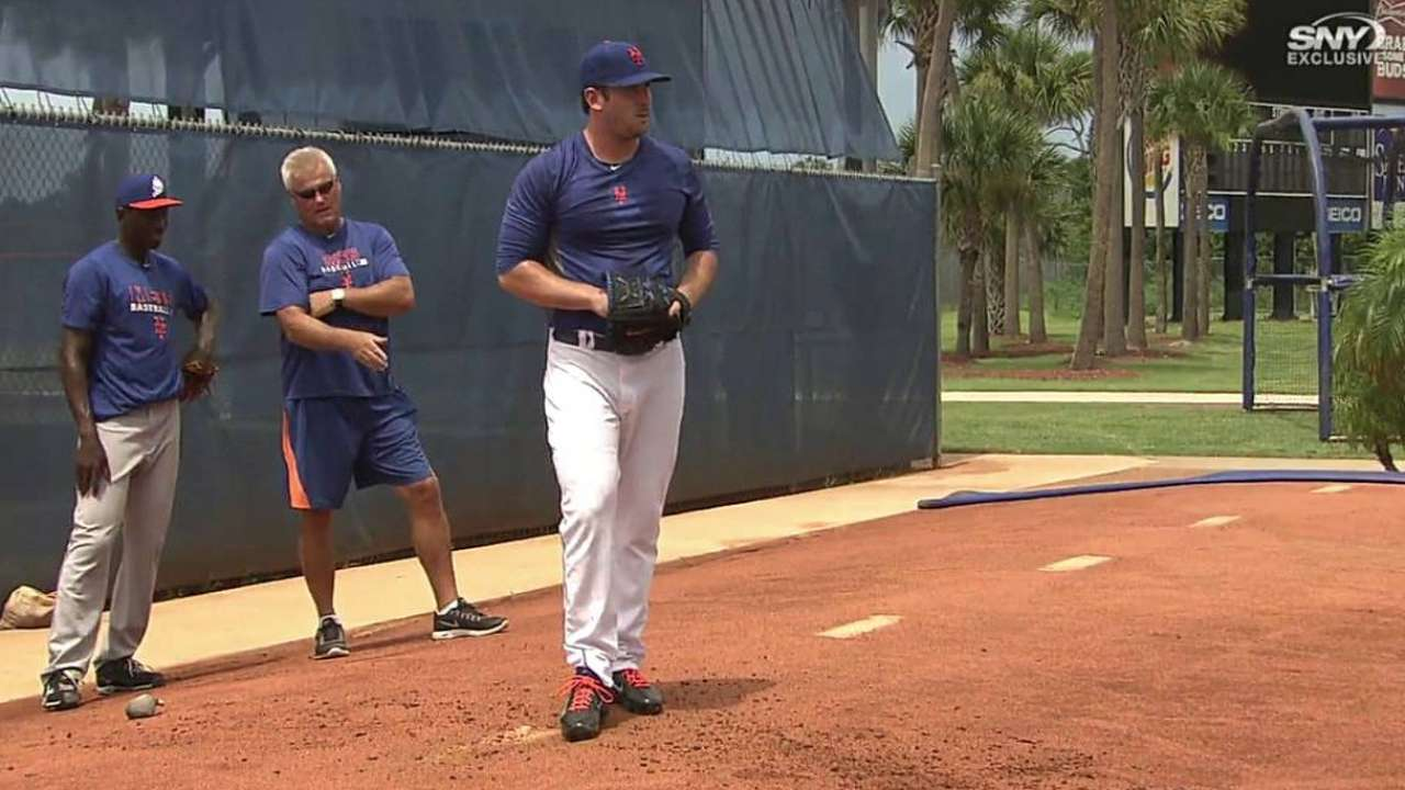 Harvey takes rehab to Florida, throws bullpen session