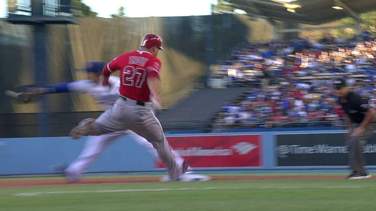 Trout keeps infield hit off Kershaw despite challenge