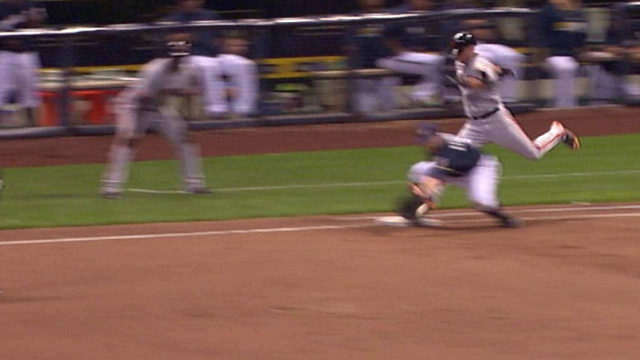 Overturned call seals Brewers' victory in ninth