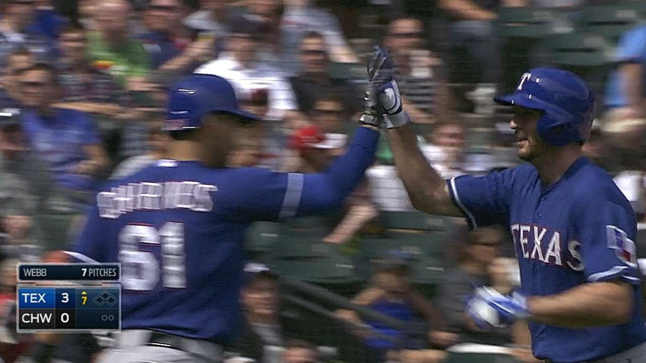 Rosales belts pair of homers to pace Texas in finale