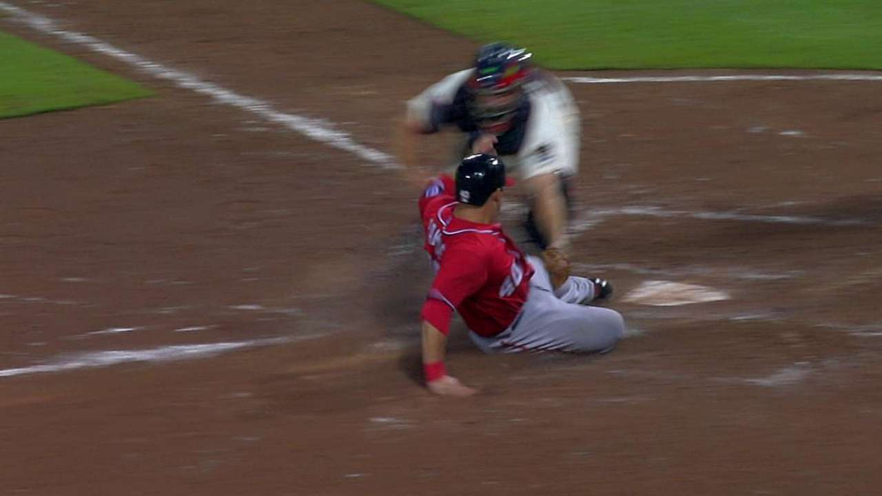 Play at plate overturned after Gonzalez's challenge