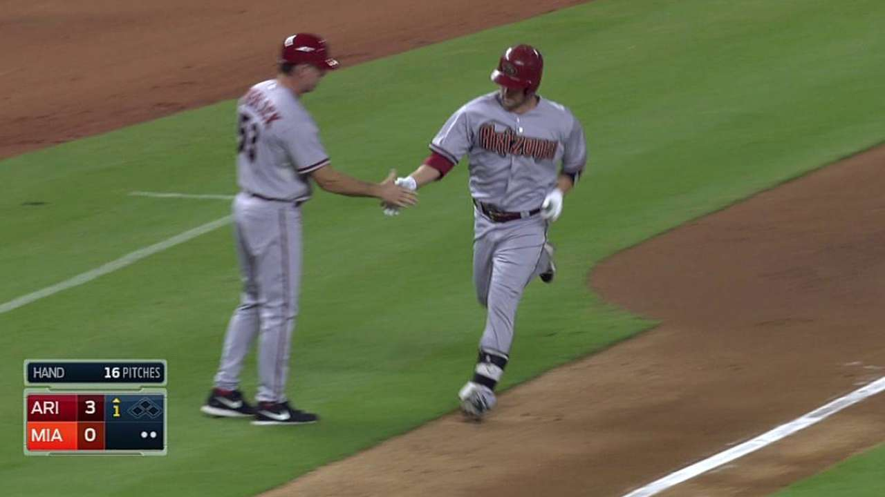Cahill, D-backs escape jams as homers hold up