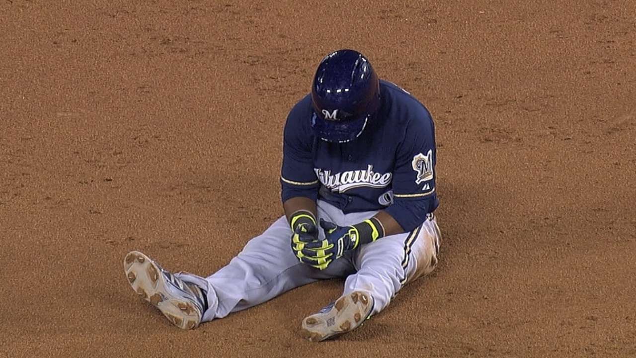 Segura hurts hand while drawing interference call