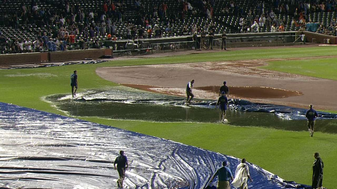 Tarp troubles lead to delay, shortened game