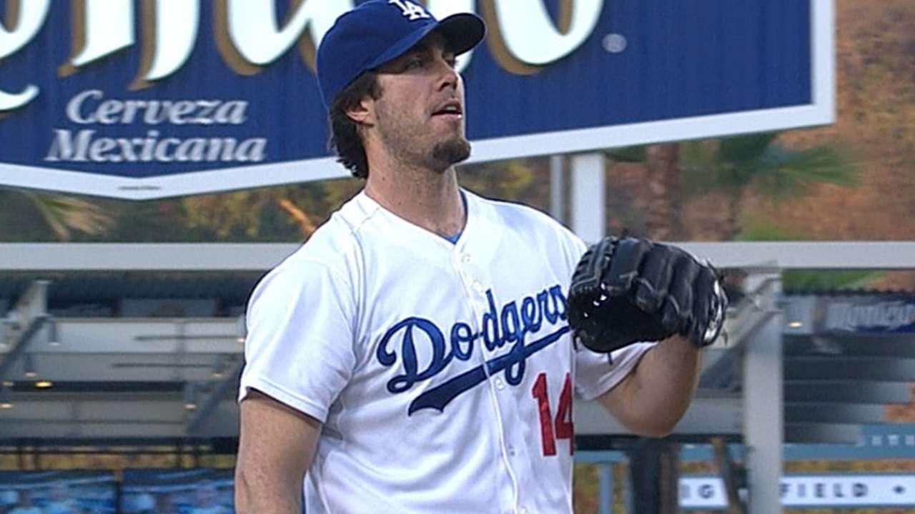Dodgers maintain lead behind Haren's stellar start