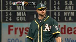 A's pounce on wild pitch to grab share of first