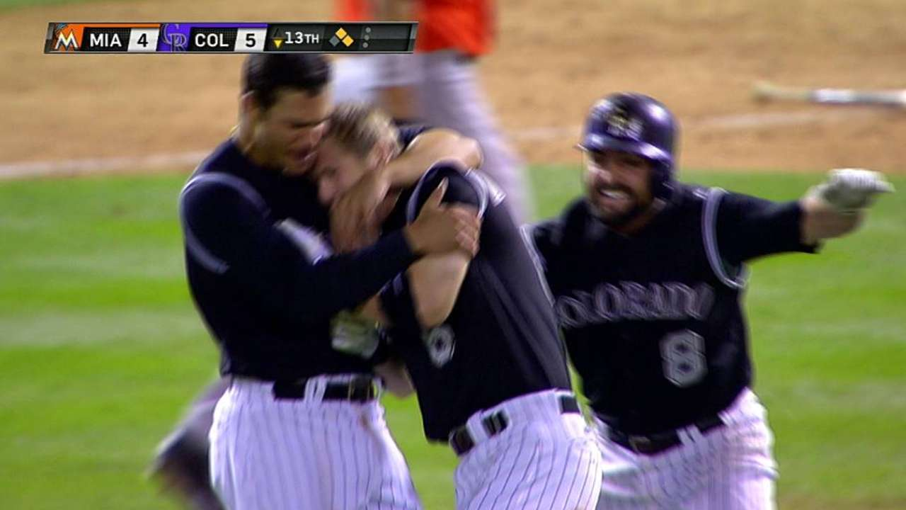 Dickerson forces extras, lifts Rockies in 13th