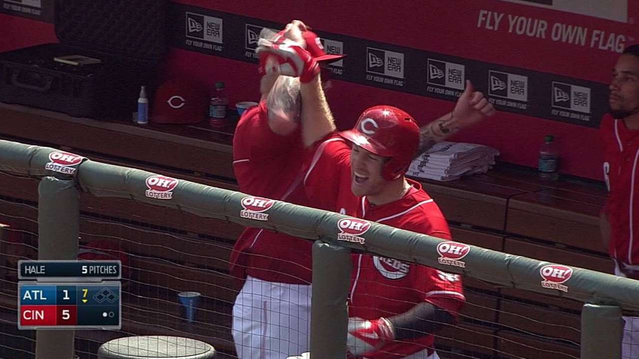 Reds survive ninth to earn split against Braves