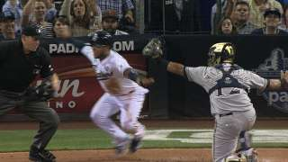 Two reviews go Brewers' way against Padres