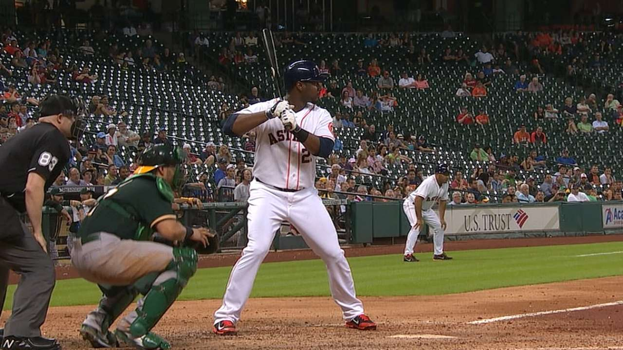 Carter's clutch homer helps Astros sink A's