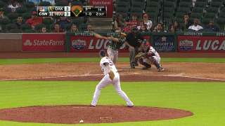 A's rally late to keep AL West lead in sight