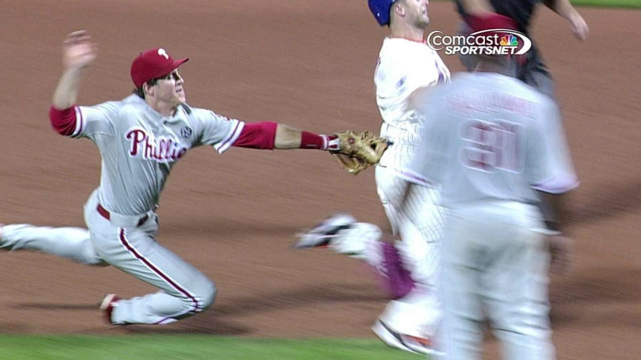 Phils get safe call overturned, complete double play