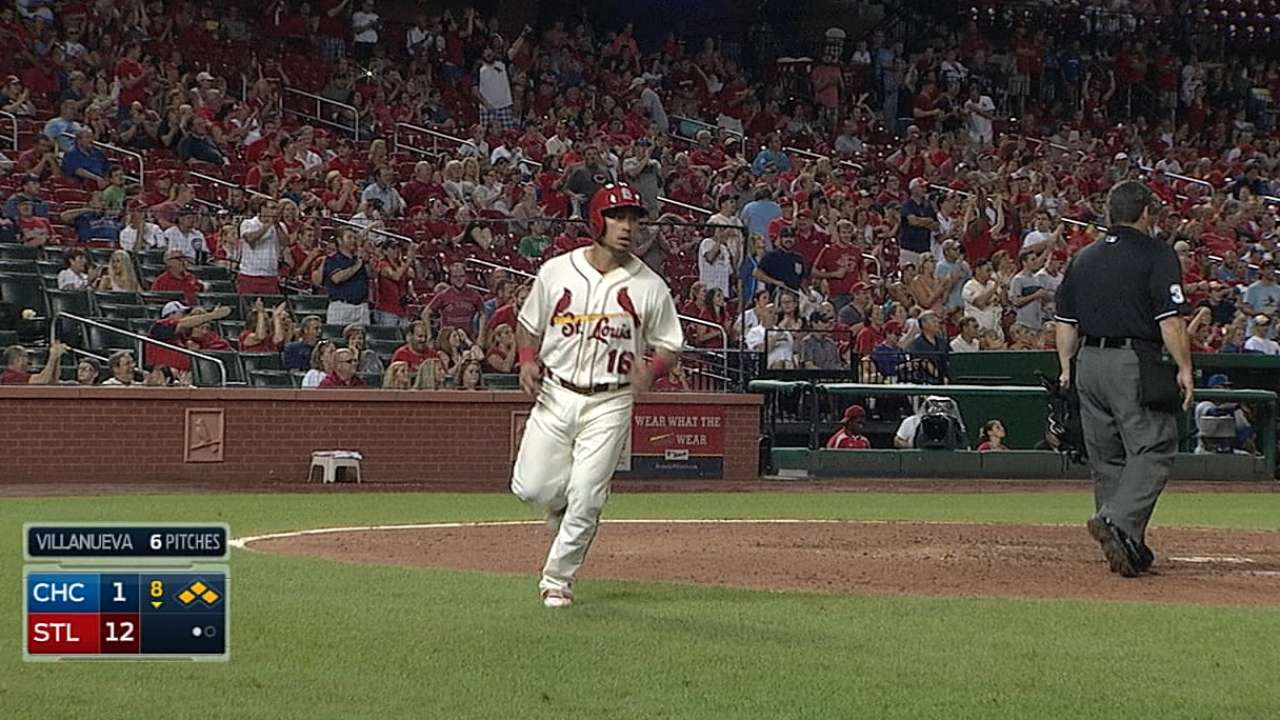 Holliday's swings, big eighth give Cards the split