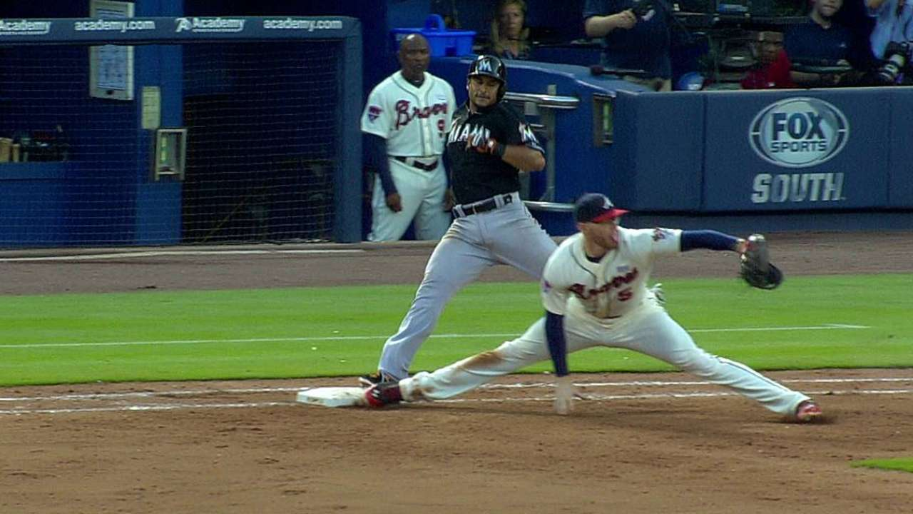 Marlins challenge, but close call goes to Braves