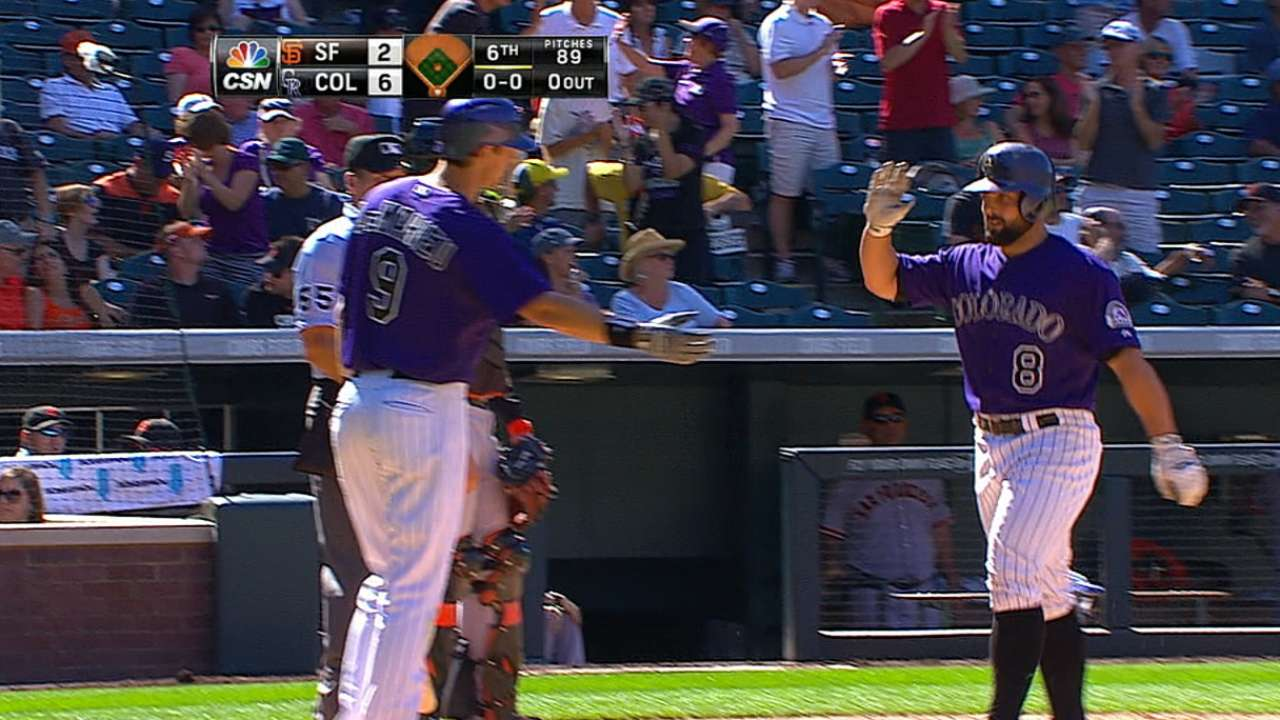 Four homers boost Rockies over Giants