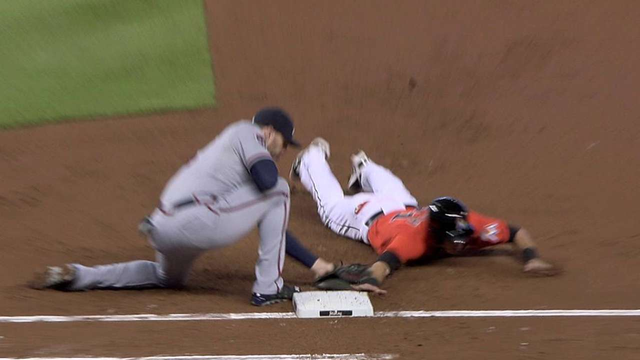 Teheran picks off Yelich after replay review