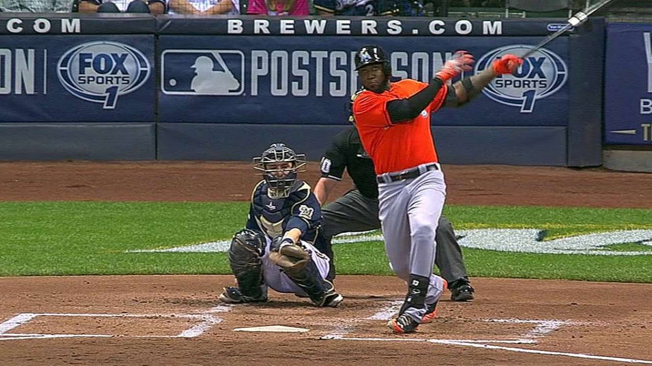 Marlins crush three homers, stay in postseason mix