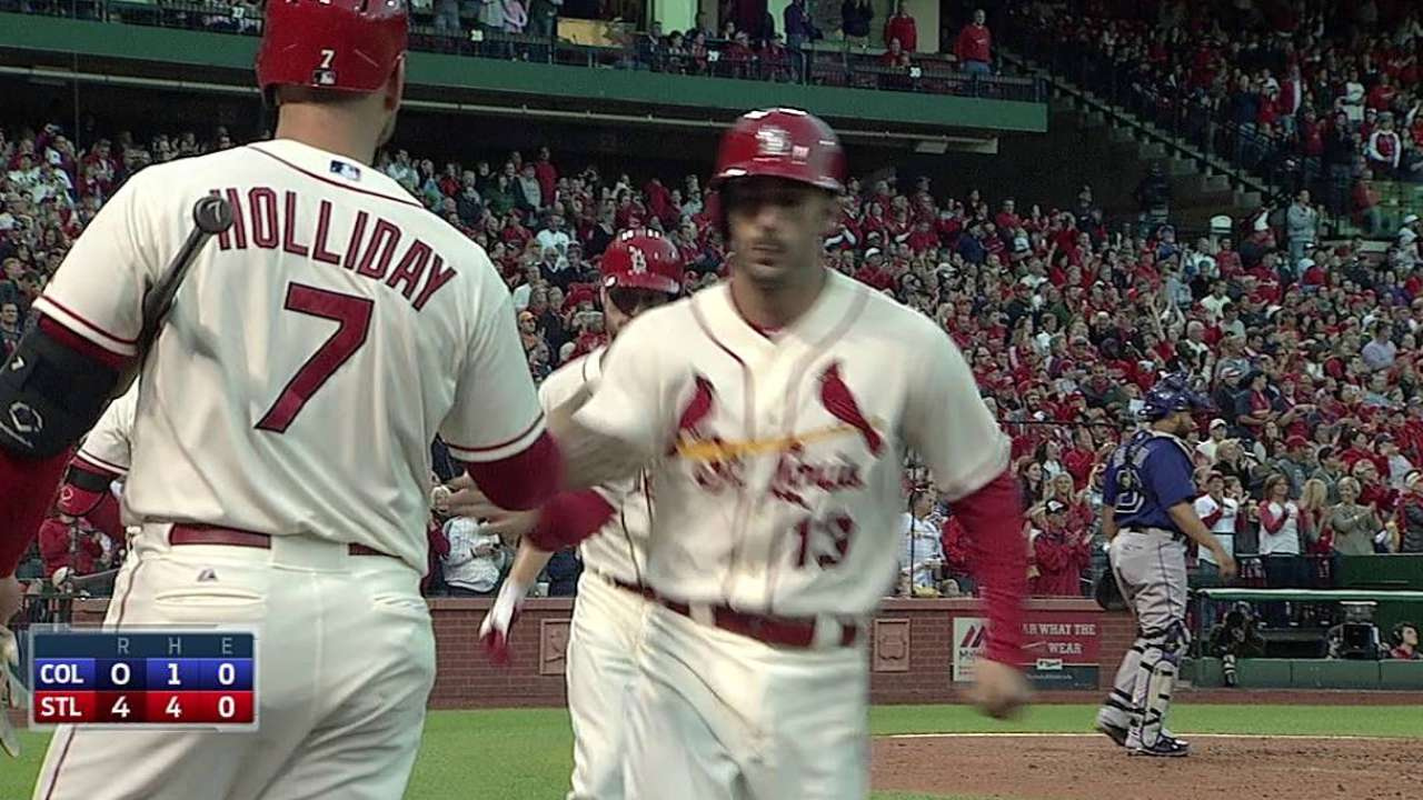 Cards hold on late to bolster lead in division