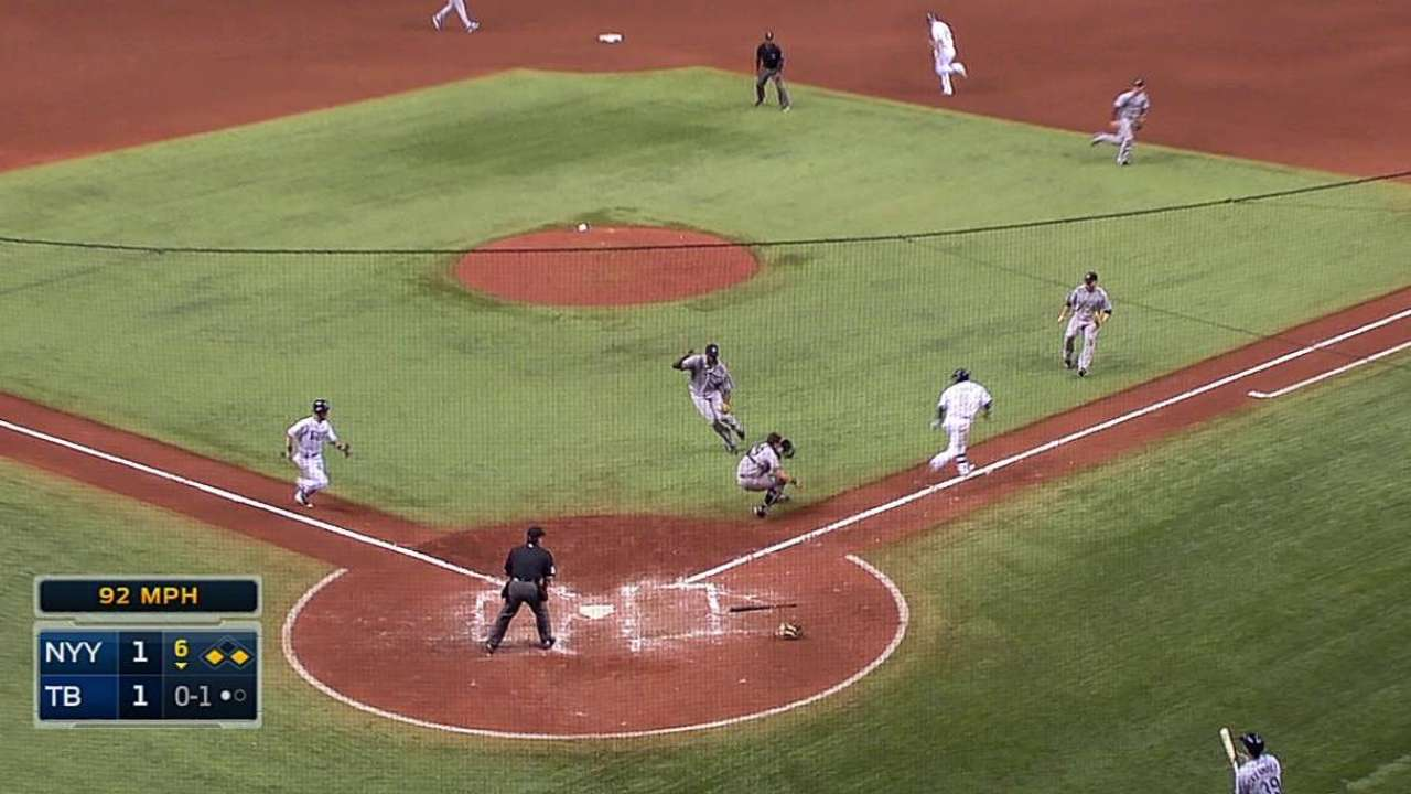 Rays open floodgates on Yanks after close call