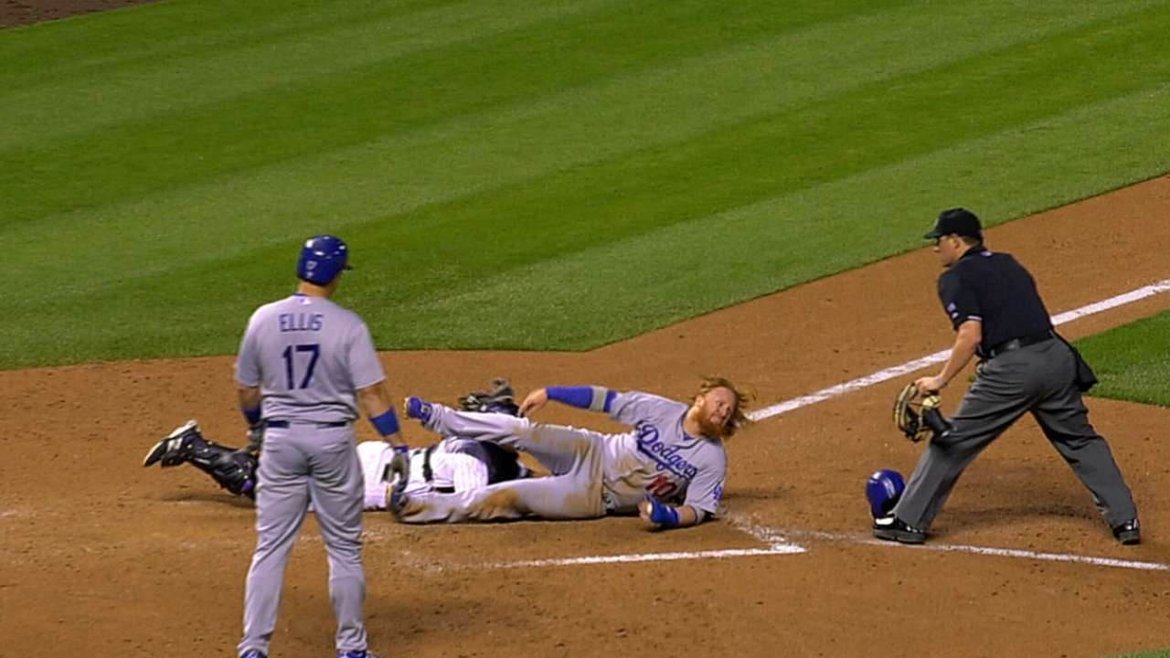 Turner out after plate-blocking review vs. Rockies