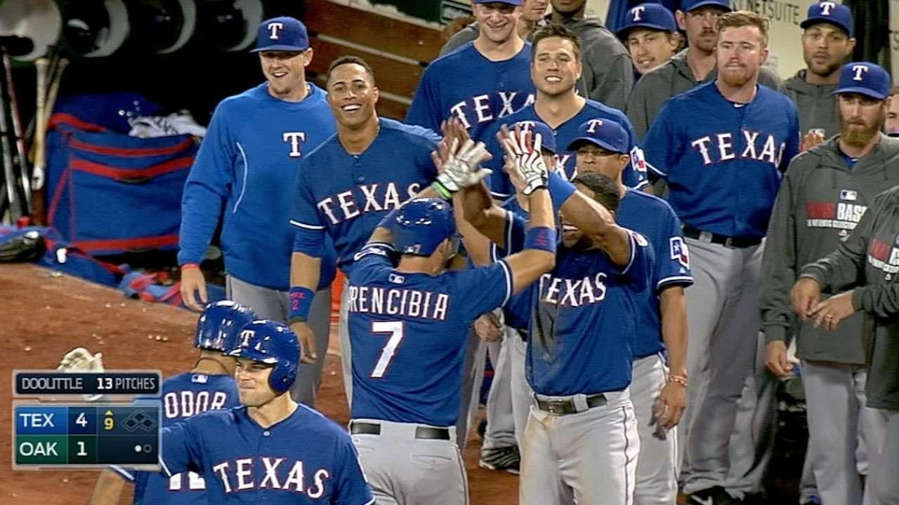 Rangers stun A's with wild ninth-inning rally
