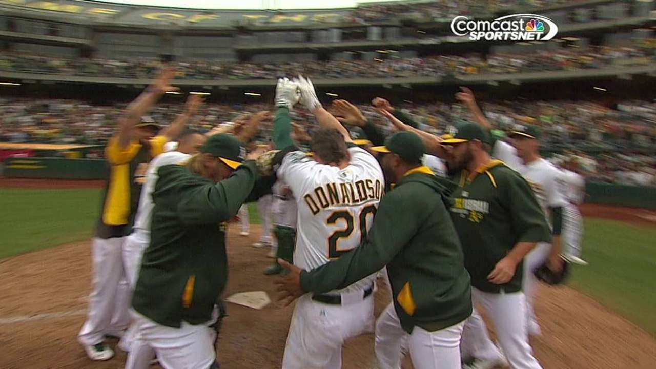 Donaldson's homer in 10th keeps A's in WC lead
