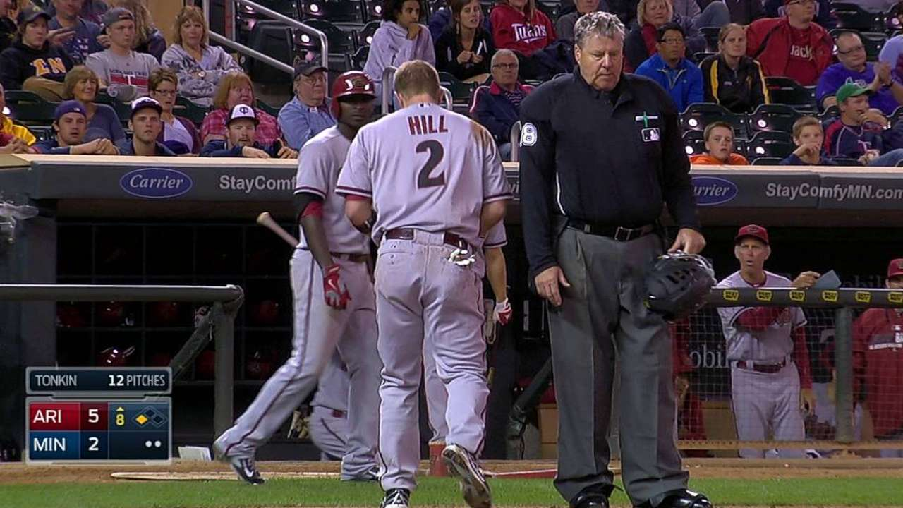 Hill dislocates pinkie sliding into home plate
