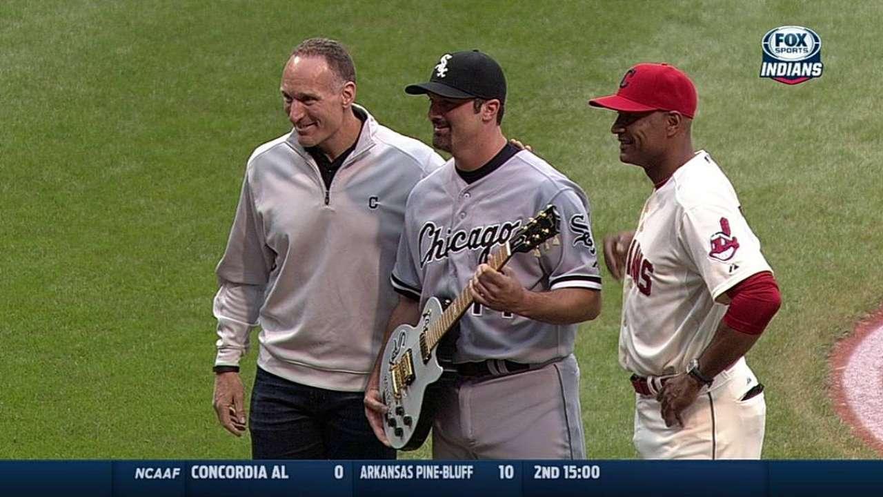 After packing bat, Konerko picks up guitar