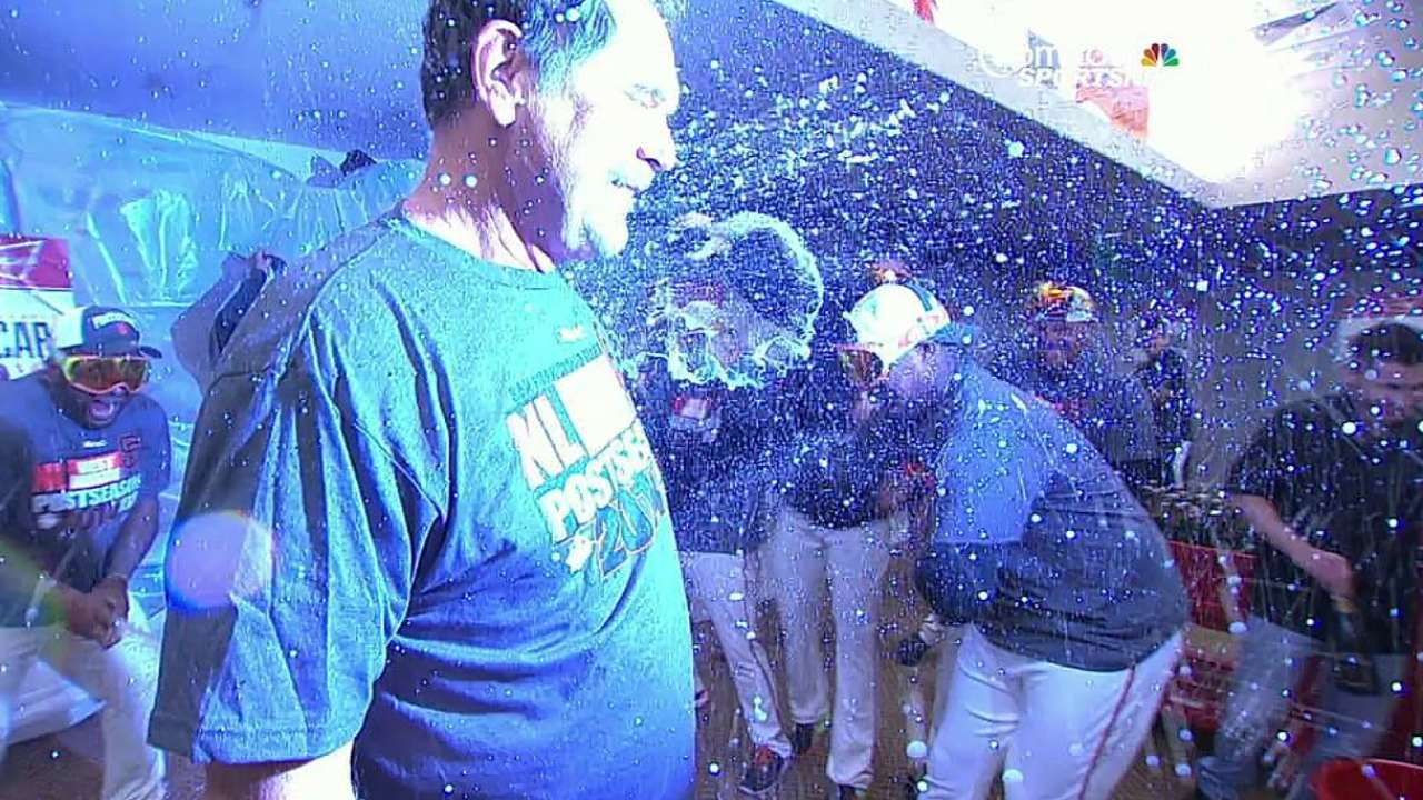 Giants clinch Wild Card, then wait to celebrate