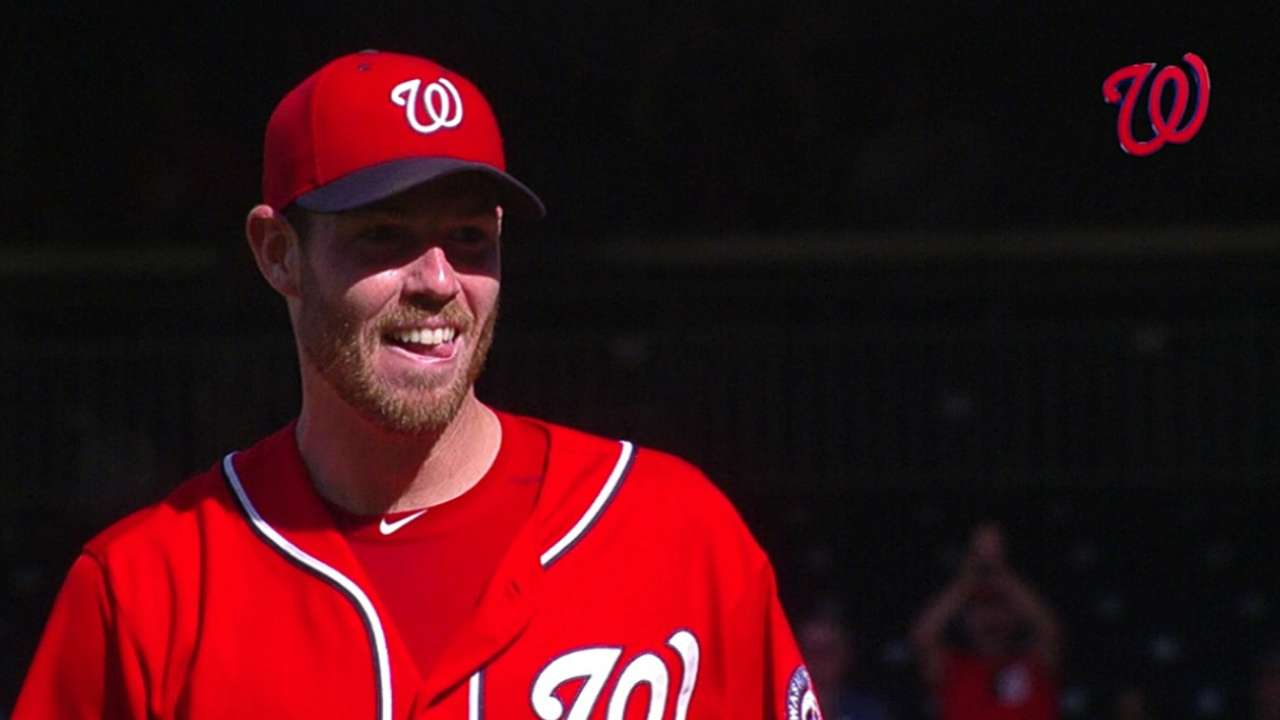 Nats grab top seed in NL on Fister's three-hit gem