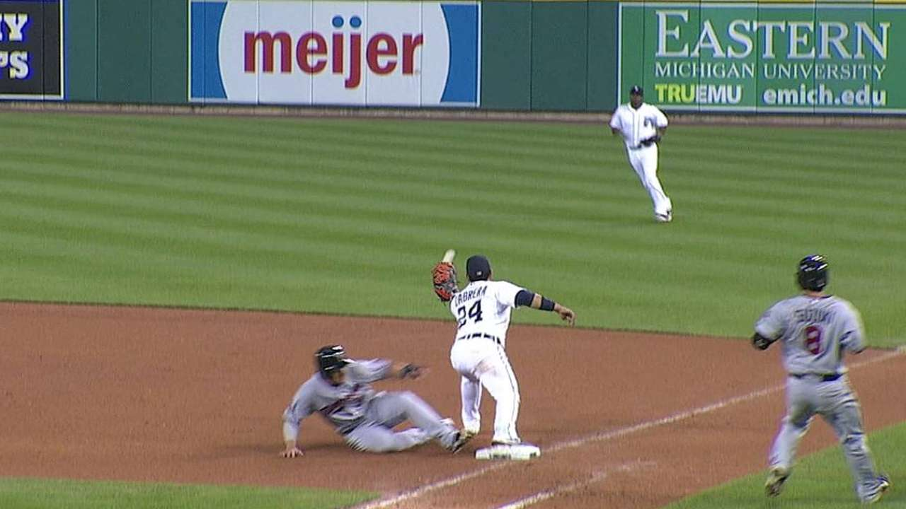 Tigers' challenge results in inning-ending double play