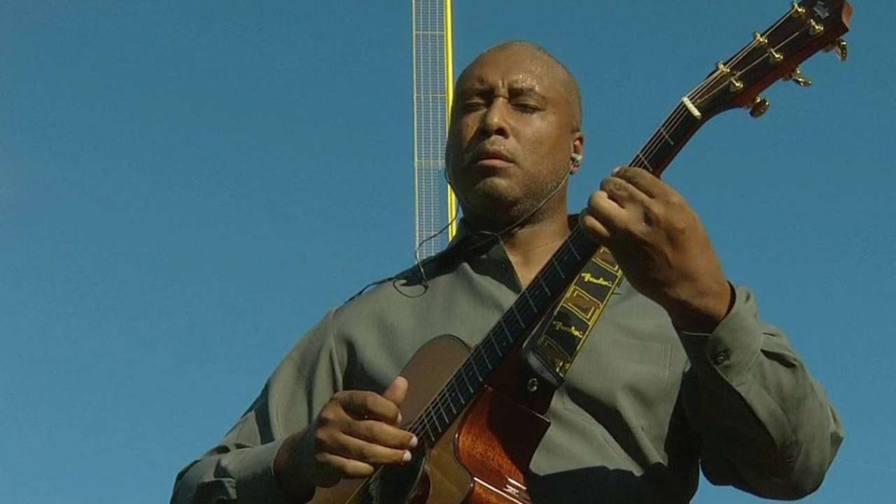 Williams plays guitar at Fenway