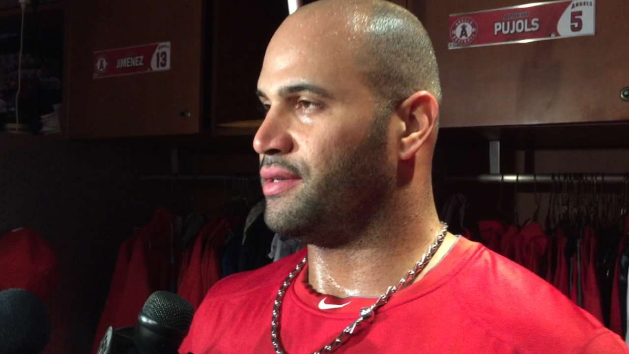 Pujols offers younger Halos tips for playoffs