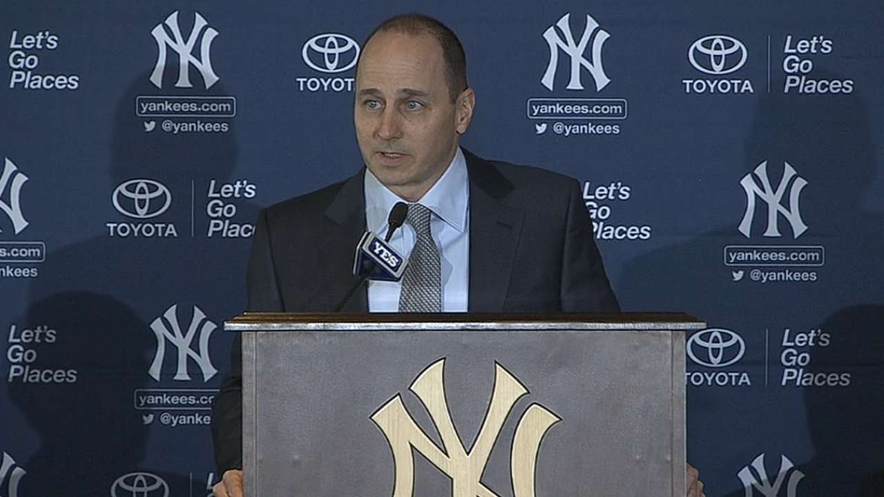 Cashman signs three-year deal to continue as GM